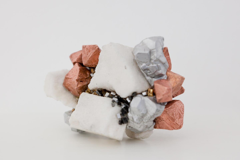 Visual of H / AlCuTaAu: a New Artificial Mineral