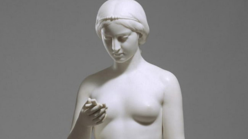Visual of 19th Century Sculpture Seems to Be Holding a Smartphone
