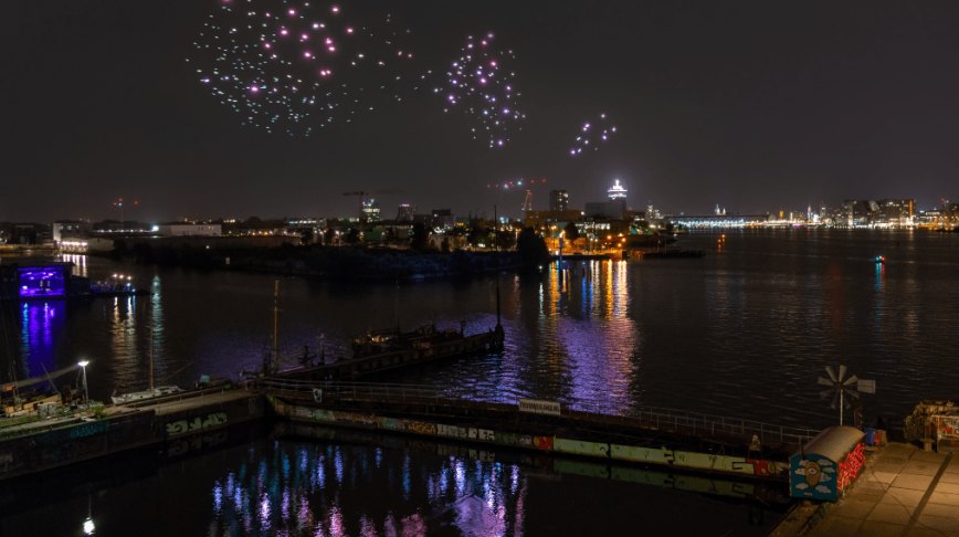 Visual of Flock of Drones fly over Amsterdam