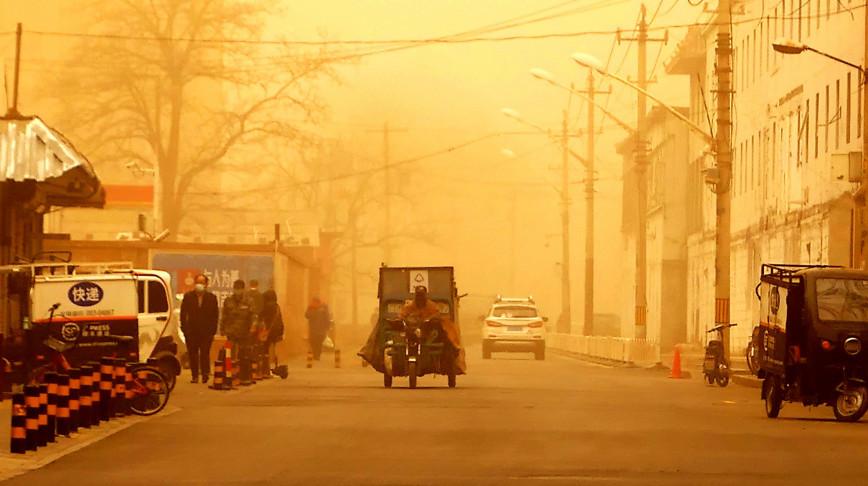 Visual of Beijing's dust storm: part humans, part nature